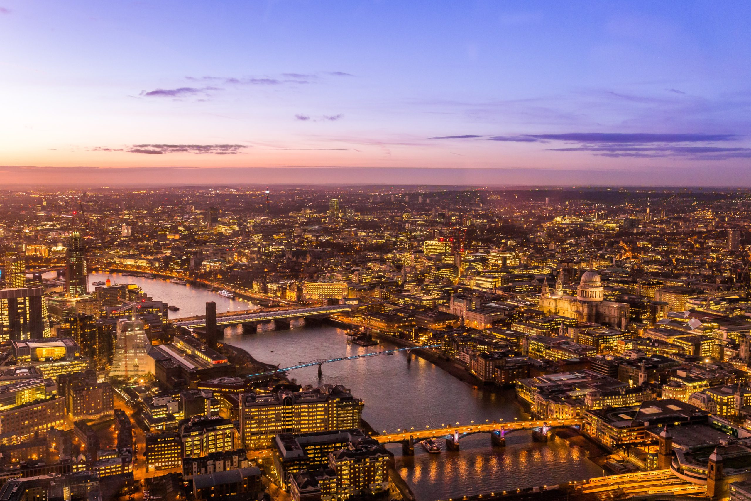 Overhead shot of London skyline with River Thames at sunset