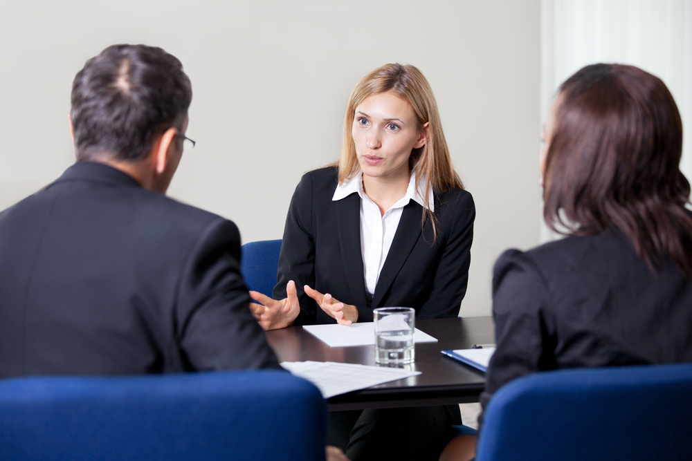 Two usiness professionals in a meeting with their lawyer